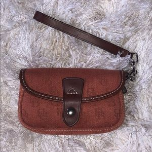 Dooney & Bourke burnt orange wristlet